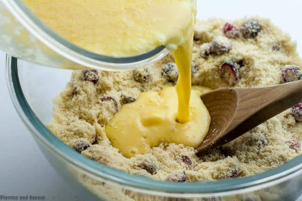 Combining ingredients for Gluten-Free Cranberry Lemon Muffins