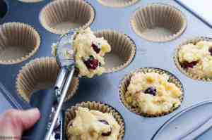 Filling muffins cups to make Gluten-Free Cranberry Lemon Muffins