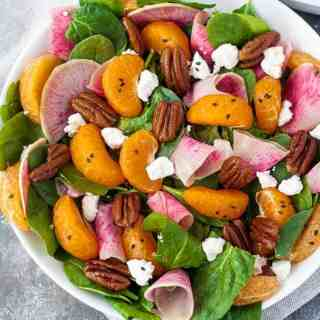 Watermelon Radish and Satsuma Spinach Salad with goat cheese and maple-glazed pecans