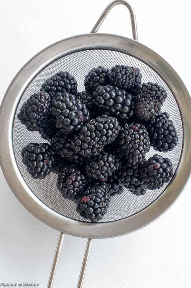 Blackberries in a sieve