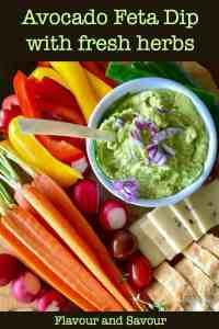 Avocado Feta Dip with fresh basil surrounded by fresh veggies