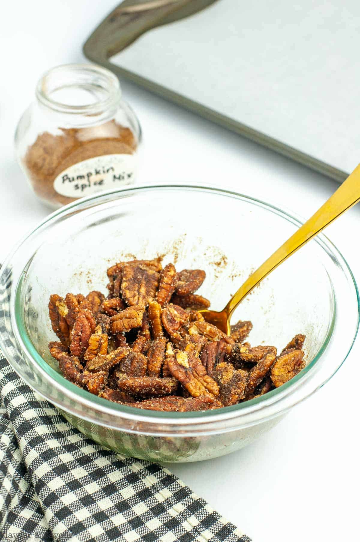 Pumpkin Spice Pecans in a bowl with a spoon