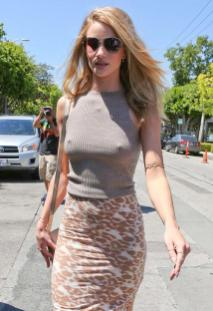 Rosie Huntington-Whiteley had a minor wardrobe malfunction after deciding to go braless, showing off her nipples through her top. Awkward