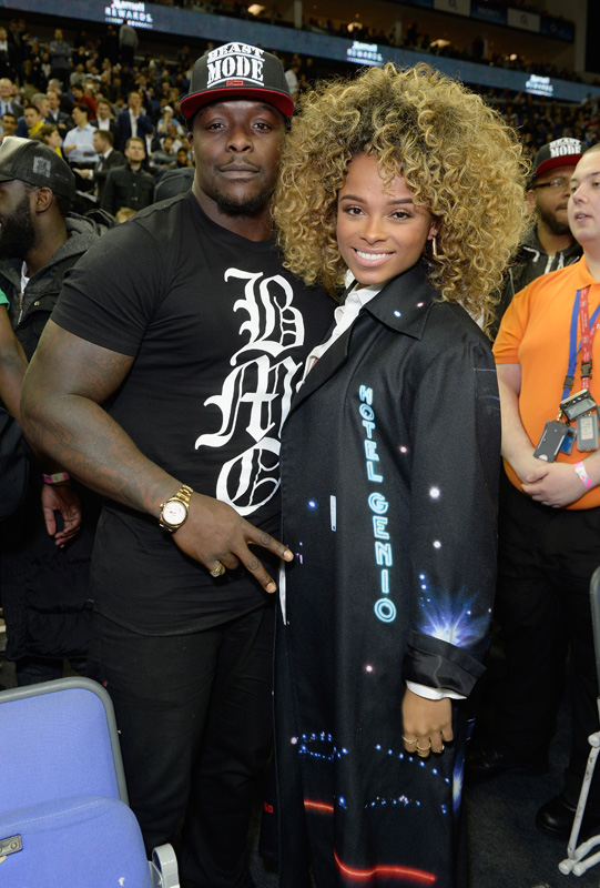 LONDON, ENGLAND - JANUARY 14: Adebayo Akinfenwa and Fleur East attend Orlando Magic vs Toronto Raptors NBA Global Game at The O2 Arena on January 14, 2016 in London, England. (Photo by David M. Benett/Dave Benett/Getty Images for NBA)
