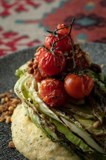 Grilled hispi cabbage, Stilton polenta, tomato relish, pinenuts