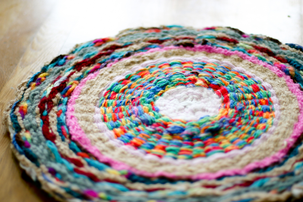 I Decided I Like The Finger Knitting Hula Hoop Rug Most On Our Wall.