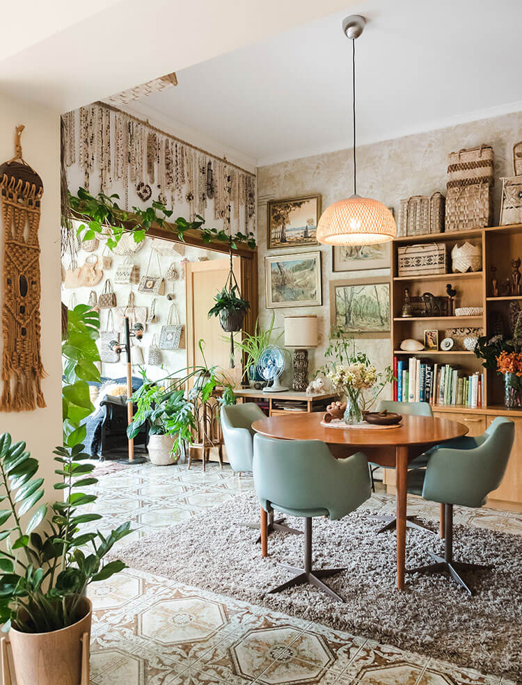 The interior of a vintage-inspired home with floral wall paper and antique decor.