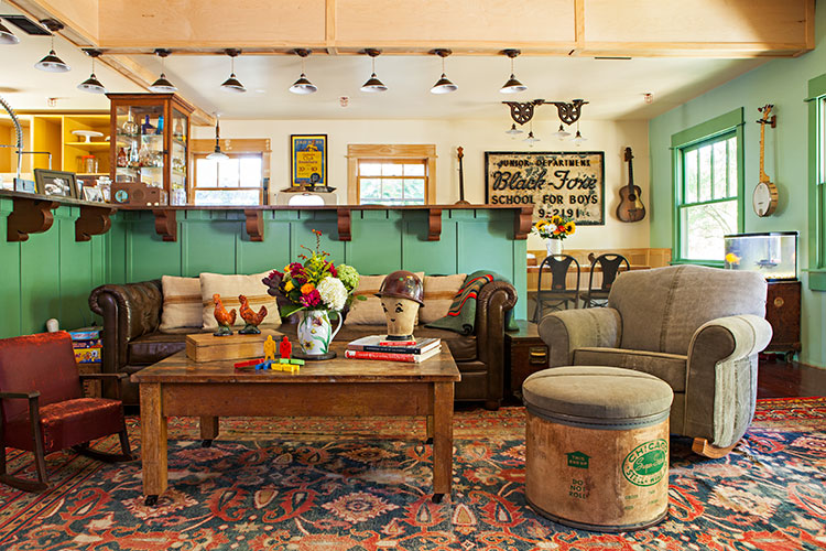 A rustic renovation detailing the home's living room and its antique fixtures.