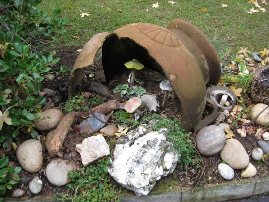 Large broken pot, salvaged into a garden feature!