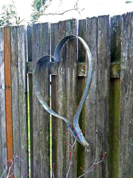 Patty Hicks's barrel hoop heart hung ion her fence