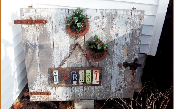 """The 'rust' sign on the barn door by my back door. Will have to put it a little higher in the spring as the hostas grow tall and would cover it where it hangs now."""