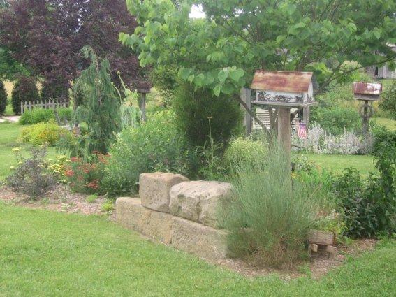 Soft and dreamy flower beds sprawl through the garden