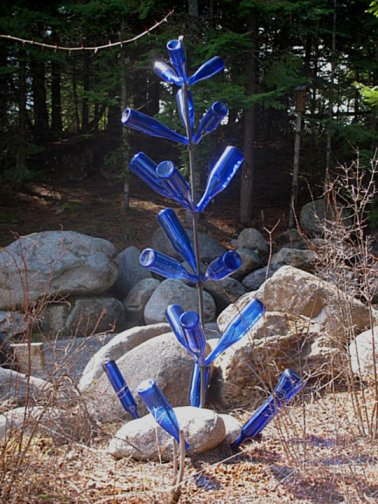 Kirk Willis' bottle tree, cool and blue, looking good against the green trees