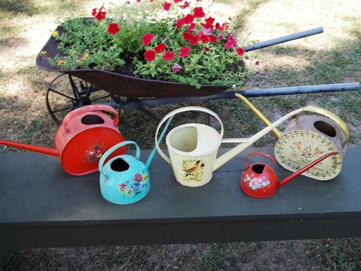 Small vintage watering cans