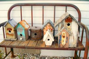 Birdhouse bench welcomes you to Sue's home.