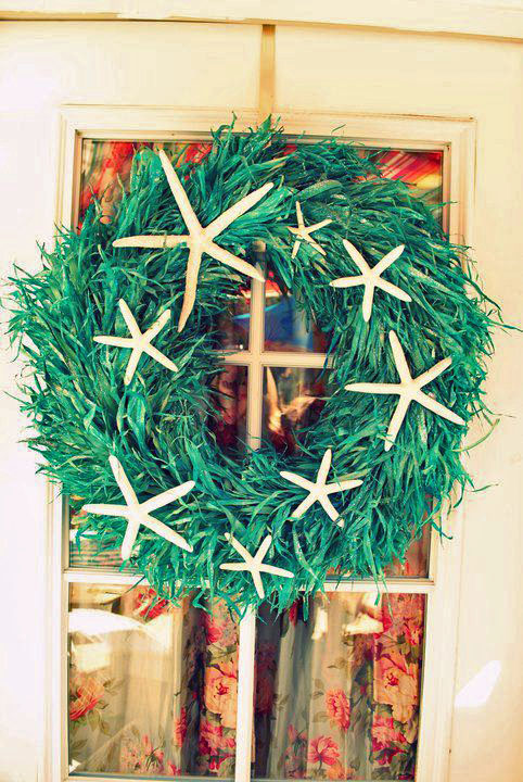 "Joy Gabler says, ""I bought the base and added the shells! When you live by the beach you have to have some star fish on your wreath!!"""