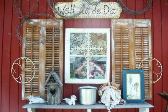 Old window, shutters and object d' rust make a classic Flea market garden vignette.