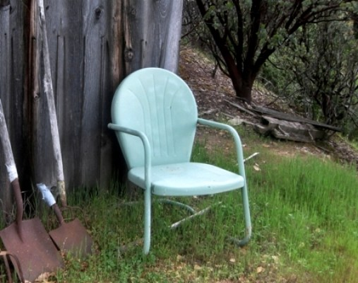 The sun has turned this green chair a powdery teal