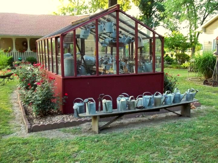 Debbie's fabulous greenhouse, filled with watering cans!