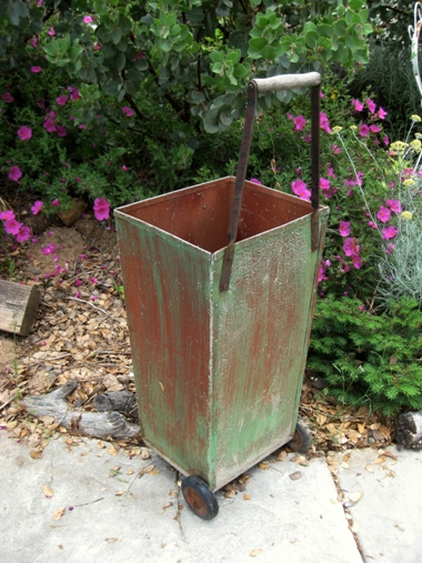 Wheely bin, painted in two colors long ago