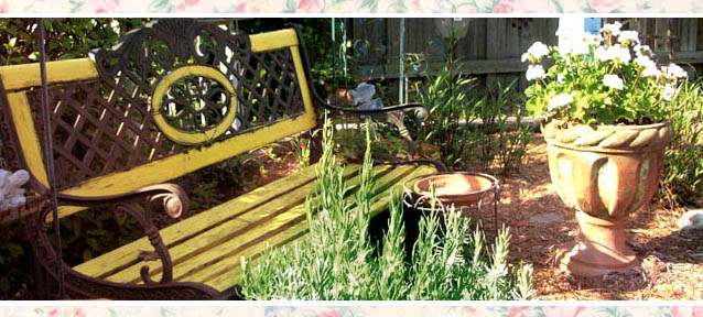 Bright paint on an old bench warms a corner of a colorful garden