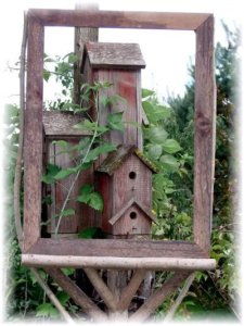 Our birdhouse condo on a big post outside