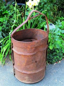 Lovely rusty patina on this bucket. What flowers should Cindy plant here?