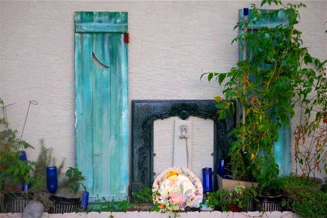 Tanya Goldsmith turquoise shutters set off other gem-like details.