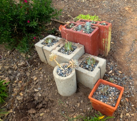 Square shapes and two round cement and terracotta pieces were all gathered at the site