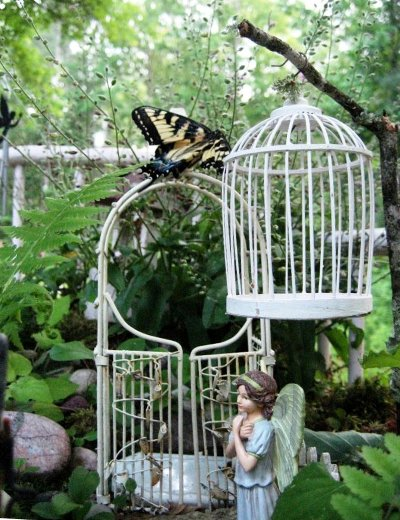 Barbara Stanley's mini birdcage matches the arbor in her fairy garden