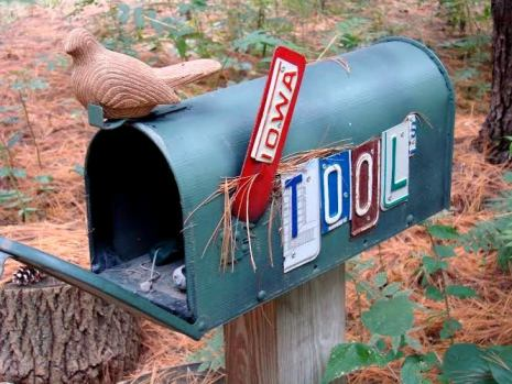 Jeanne's mailbox with letters cut from old license plates