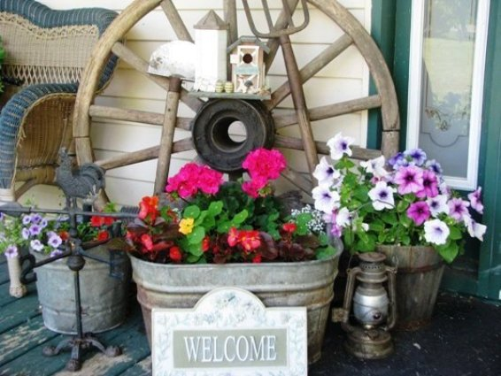 Galvanized, iron and rust,…all accented with fresh flowers in Catherine Lepage's vignette
