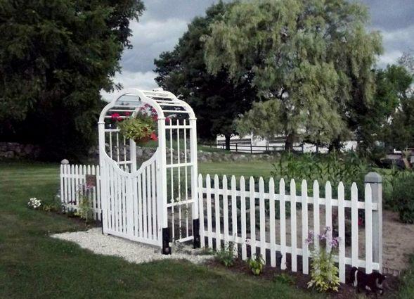 Anne Beauchemin's white picket fence arbor