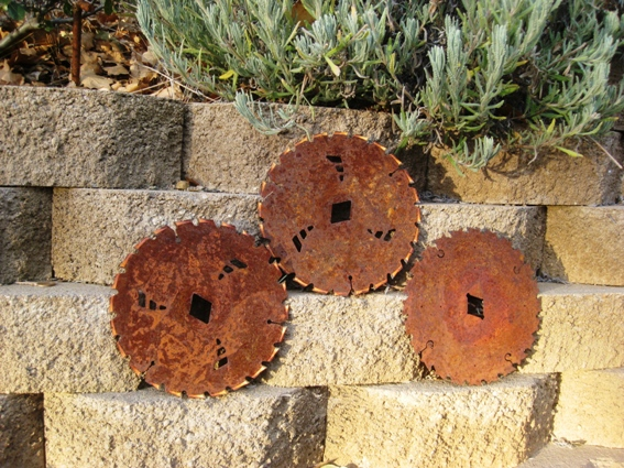 Three saw blades used when building our house and set on a wall