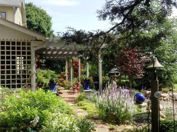 Porches and arbors are another unifying element in the garden