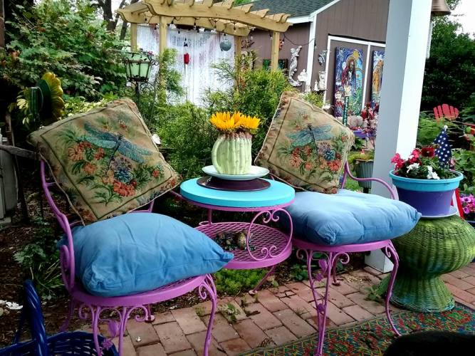 Dragonfly pillows on a bright seating duo