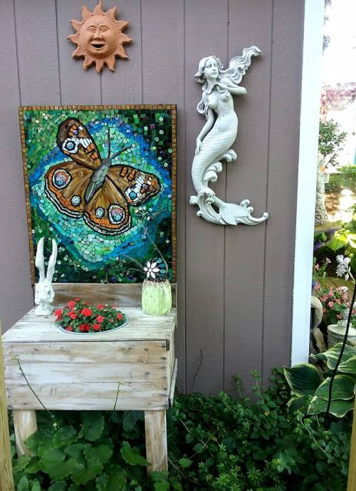 Made from an old pallet, a butterfly mosaic andthe Mermaid was a gift from my daughter!