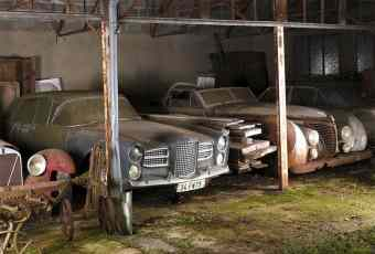 Vintage cars in a barn from Roger Baillon Collection