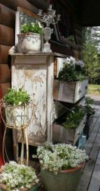 Vintage buffet as fun porch display with plants