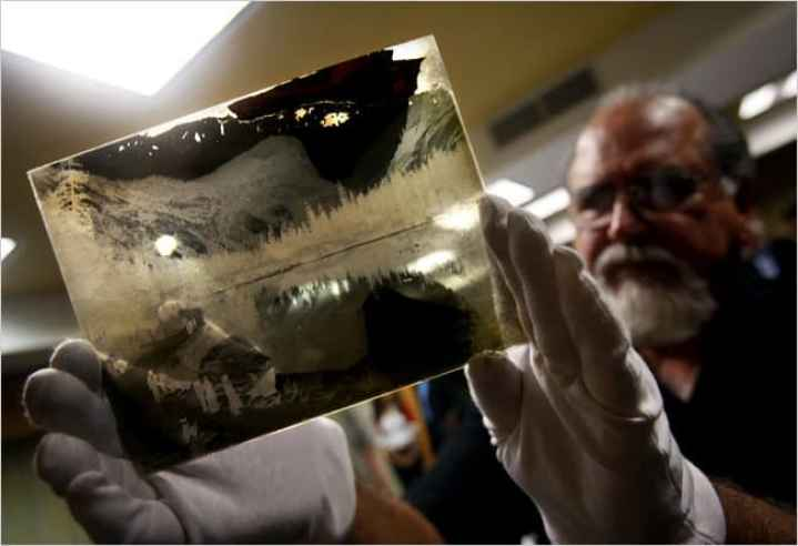 Rick Norsigian with one of the 65 glass negatives he bought in a California garage sale. Prints from them are being sold as the work of Ansel Adams. Credit Eric Paul Zamora/Fresno Bee/MCT, via Getty Images