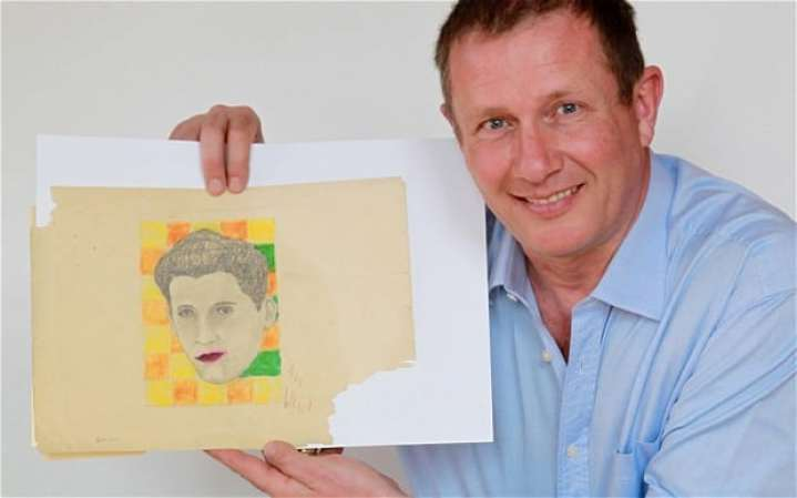Andy Fields with the portrait of Rudy Vallee by Andy Warhol (© SWNS)