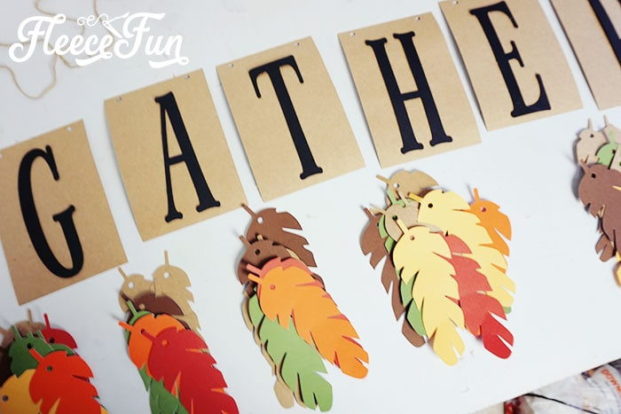 Thanksgiving project:  This lovely Gather Thanksgiving banner DIY is perfect for adding beauty to any Thanksgiving and fall decor.  With it's simple, but elegant design it is the perfect accompaniment to your festivities.