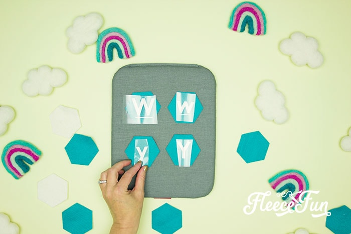 Vinyl letting centered on Hexagons on easy press mat. This Matching Game DIY is perfect for learning and made to be durable to last for several years of abuse from kids!