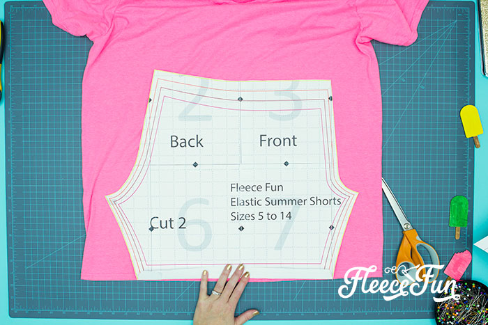 picture of shorts pattern on t-shirt for upcycling. You can learn how to make shorts with this easy to follow step by step tutorial. Comes with a free PDF sewing pattern, with easy instructions.