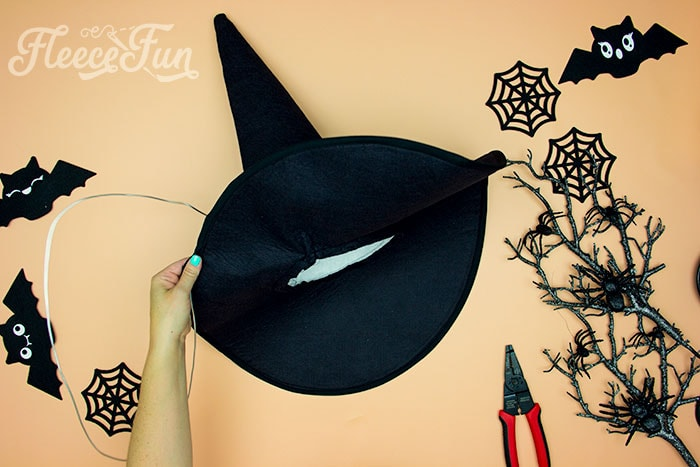 Showing sire being threaded around the brim of the witch hat. Learn how to make a witch hat with this free pdf pattern and step by step tutorial. This couture style hat is sure to be a favorite year after year.