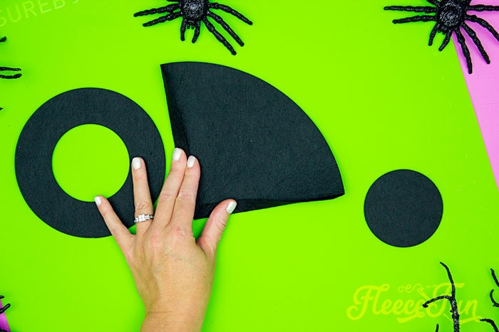 folding both edges of the cone over/ This DIY Mini Witch Hat is no sew and comes with a free PDF pattern and SVG template to make it a breeze! 3 mini sizes so you can make the perfect hat!