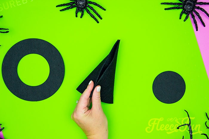 brining the cone of the witch hat together. This DIY Mini Witch Hat is no sew and comes with a free PDF pattern and SVG template to make it a breeze! 3 mini sizes so you can make the perfect hat!