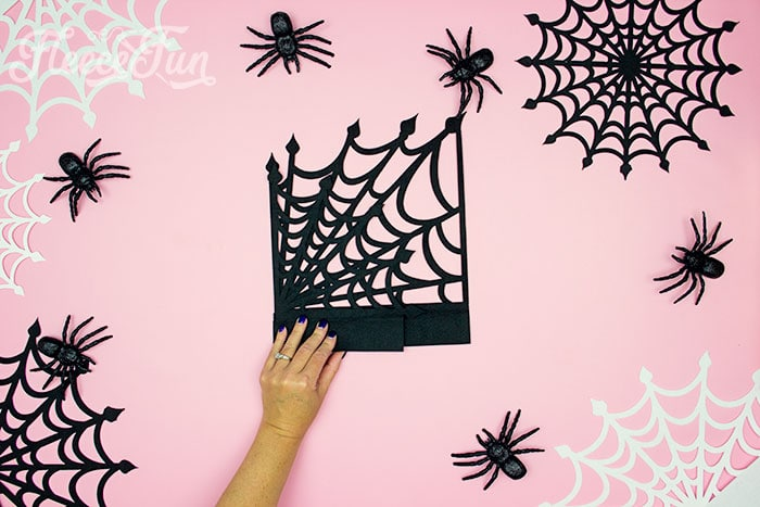 spiderweb folded in half. These Spider Web doilies Free SVG files are the perfect finishing touch to you Halloween decor!  The free SVG includes 3 designs for decorating spookiness!