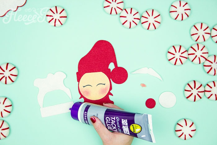 Glueing on the beard. Items needed. With a Free Ornament Template you can make this adorable felt Santa! This homemade ornament is no sew and makes for a wonderful gift.