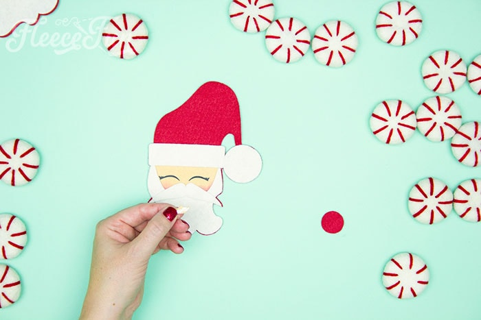 Gluing on the nose. Items needed. With a Free Ornament Template you can make this adorable felt Santa! This homemade ornament is no sew and makes for a wonderful gift.